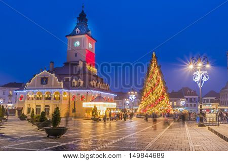 Decorated Christmas tree in the main center square and market of Brasov the most beautiful medieval town of Transylvania decorated in Christmas light Romania