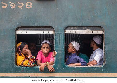 DHAKA BANGLADESH- SEPTEMBER 09 2016. Unidentified children going home through train.