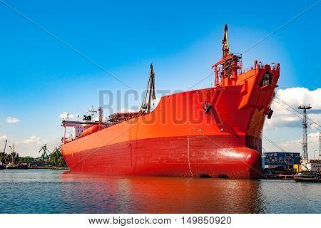 A big ship under construction at shipyard.