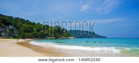 Tourists on Kata Noi beach on a sunny day. Phuket, Thailand