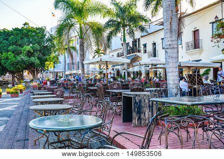 SANTO DOMINGO, DOMINICAN REPUBLIC - JANUARY 29, 2016: Famous place Las Atarazanas in Spanish Square with prestigious restaurants.