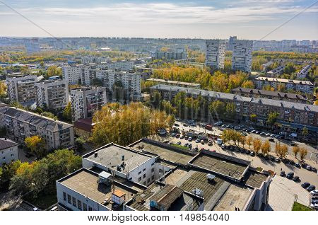 Tyumen, Russia - September 27, 2016: Aerial view on Builder palace of culture and sleeping neighborhood large-panel houses, so called KPD. Respubliki street