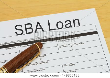Applying for a SBA Loan SBA Loan application form with a pen on a desk
