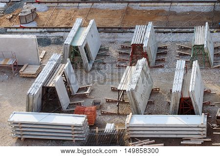 Grey concrete slabs preparing for building under construction top view
