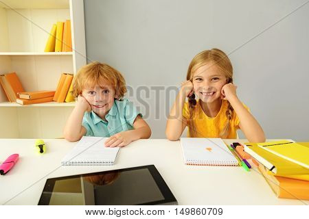 learning and next generation concept, boy and girl smiling and looking into camera