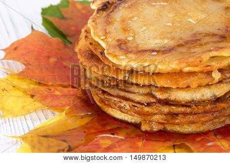 Pancakes With Maple Syrup On Autumn Multicolored Leaves