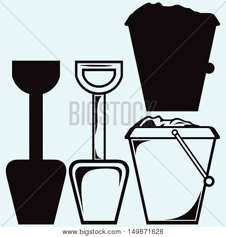 Bucket and spade with sand kid toys tools symbol. Isolated on blue background. Vector silhouettes