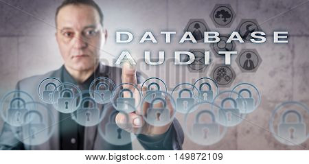 Experienced data administrator is activating a DATABASE AUDIT onscreen. Information management metaphor touching on database security procedures auditing practices and computer access control.