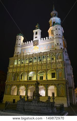 Poznan Poland - September 30 2016: Night photo of Poznan Old Town with Prozerpin's fountain and beautifully decorated facade of the city hall.