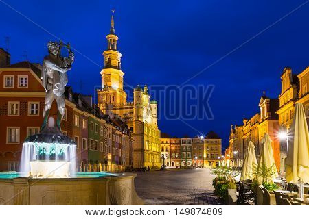 Poznan Poland - September 30 2016: Night photo of Poznan Old Town with Apollo's fountain beautifully decorated facade of the city hall and numerous highlighted townhouses.