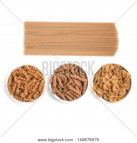 Wholemeal Pasta. Spaghetti Penne and Fusilli isolated in white background