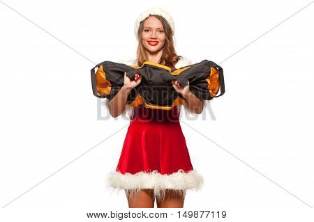 christmas, x-mas, winter, happiness concept - Bodybuilding. Strong fit woman exercising with SANDBAG in santa helper hat , isolated on White Background. Muscular blonde girl lifting weights studio shot.