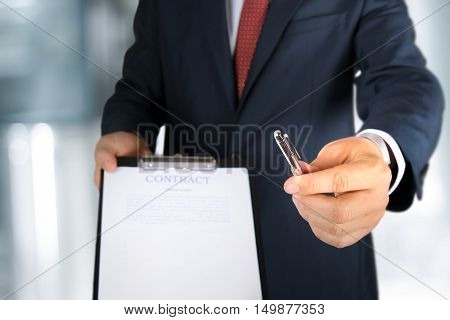Business man is offering to sign a contract business contract details