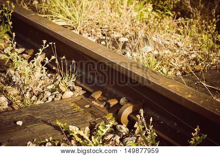 Detail of train rails, sleepers and fasteners. Old railroad
