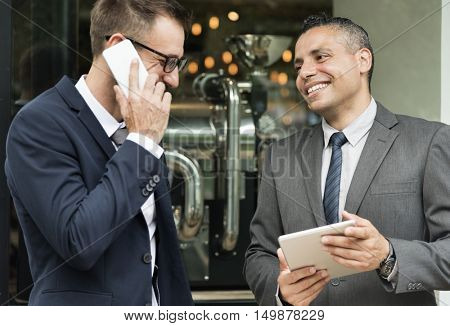 Two Businessmen Break Outdoors Concept