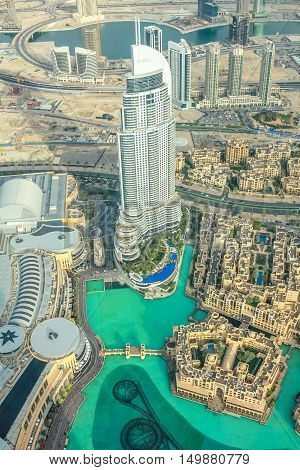 Dubai, United Arab Emirates - May 1, 2013: aerial view of Dubai Fountain area, Address Hotel and Burj Khalifa Lake in Dubai downtown, from top of the Burj Khalifa. View of shopping Dubai Mall.