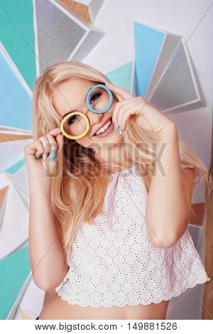 Outrageous fun girl with glasses. The concept of lifestyle and fashion.