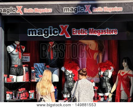 Zurich Switzerland - 25 September 2016: two girls looking at the window of the Magic X Erotic Megastore sex shop. MagicX is a business specialized in manufacturing and selling erotic articles with more than 30 stores in the country.