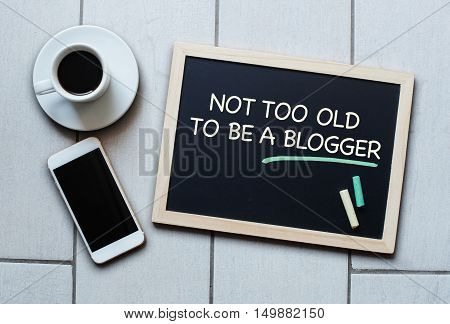 Chalkboard or Blackboard concept saying Blackboard concept saying Not Too Old To Be a Blogger. Concept of blogging and bloggers.