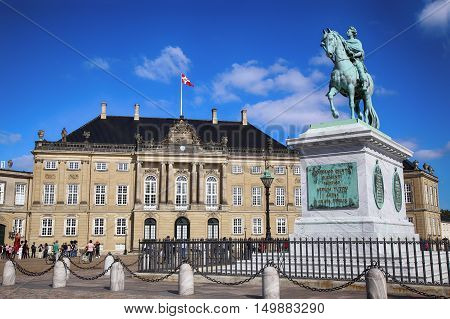 Copenhagen Denmark - August 15 2016: Sculpture of Frederik V on Horseback in Amalienborg Square it's home of the Danish Royal family in Copenhagen Denmark on August 15 2016.