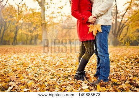 Romance in autumn in park, young couple in love - concept