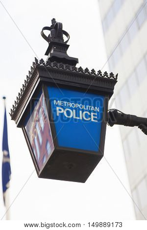Traditional British Metropolitan Police lamp sign outside police station, London, England