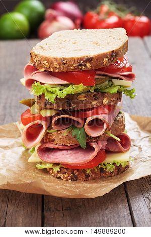 Big baloney sandwich with wholegrain bread, lettuce and tomato