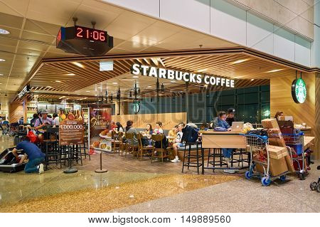 SINGAPORE - CIRCA AUGUST, 2016: Starbucks at Singapore Changi Airport. Starbucks Corporation is an American coffee company and coffeehouse chain.