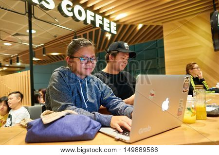 SINGAPORE - CIRCA AUGUST, 2016: people in Starbucks at Singapore Changi Airport. Starbucks Corporation is an American coffee company and coffeehouse chain.
