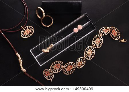 A collection of jewelry on black background