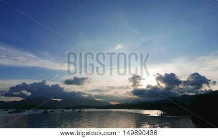 Motorboat, ocean, mountain and the cloudscape at daytime