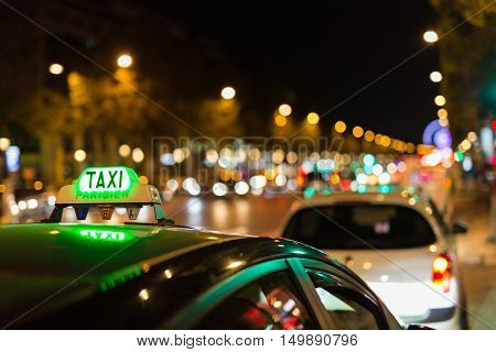 French taxi with the champs elysees avenue in background
