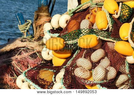 Yellow and black fishing nets, closeup, isolated.