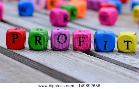 Profit word on gray wooden table closeup