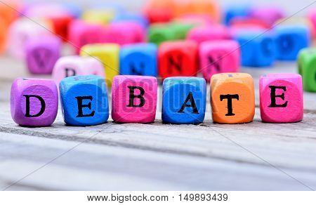 Debate word on gray wooden table closeup