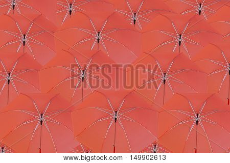 Many red umbrella concatenation to abstract background.
