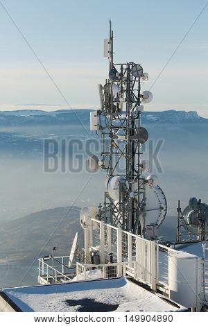Communication transmitter towers in the snow