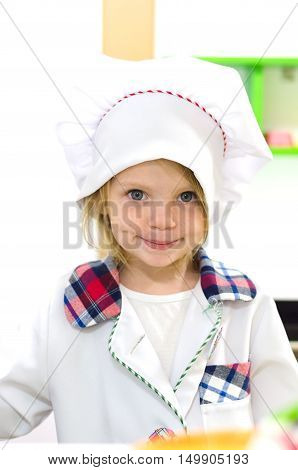 Cute little girl in white chief costume.