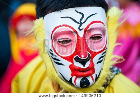 Paris France - Feb 17 2013: Chinese performer wearing a monkey mask in traditional costume at the chinese lunar new year parade