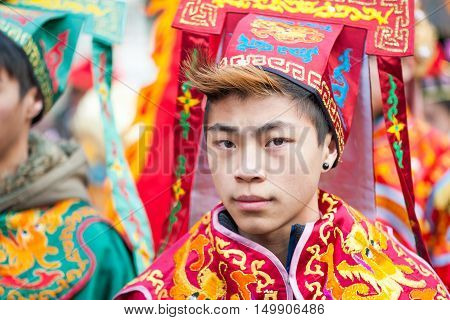 Paris France - Feb 17 2013: Young chinese performer in traditional costume at the chinese lunar new year parade