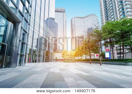 Twilight under modern buildings in Guangzhou, China, skyscrapers and streets