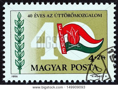 HUNGARY - CIRCA 1986: A stamp printed in Hungary issued for the 40th anniversary of Young Pioneers Movement shows Flag and 40, circa 1986.
