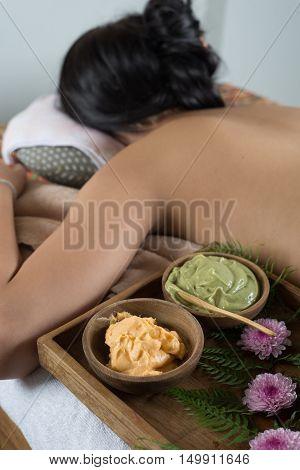 Massage series : Asian woman lying bareback on massage bed in spa