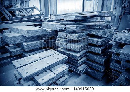 Steel semi-finished steel factory blue tone image.