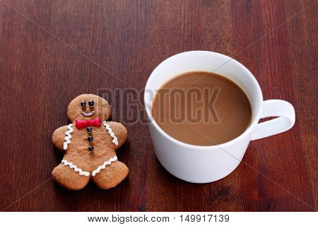 gingerbread man with cup of coffee - sweet food