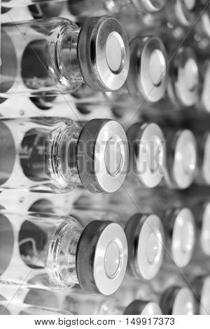 Glass vials for liquid samples. Laboratory equipment for dispensing fluid samples. Shallow depth of field.