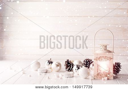Burning Lantern In The Snow With Christmas Decoration
