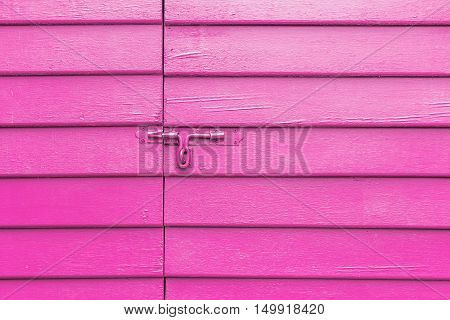 bolt the door on wall pink.The surface used as background.
