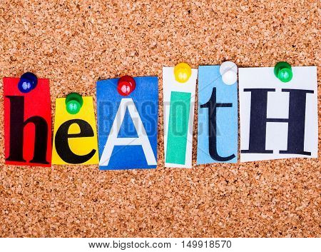 The Word Health In Cut Out Magazine Letters Pinned To A Cork Notice Board With Push Pins..