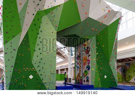 Moscow, Russia - August 30, 2016. Big climbing wall in a shopping complex Zelenopark